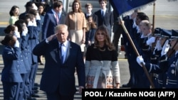 U.S. President Donald Trump and his wife, Melania, are welcomed upon arrival at the Yokota Air Base in western Tokyo on November 5.