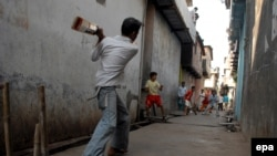 Wherever the British went, they took cricket with them, and it has flourished, as here, in Mumbai.