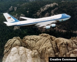 One of the two Boeing 747 planes known as Air Force One when the U.S. president is aboard flying over Mount Rushmore in 2001.
