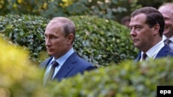 Russian President Vladimir Putin (left) and Russian Prime Minister Dmitry Medvedev visit the Anton Chekhov House-Museum in Yalta, in the annexed Ukrainian region of Crimea, in August 2014.