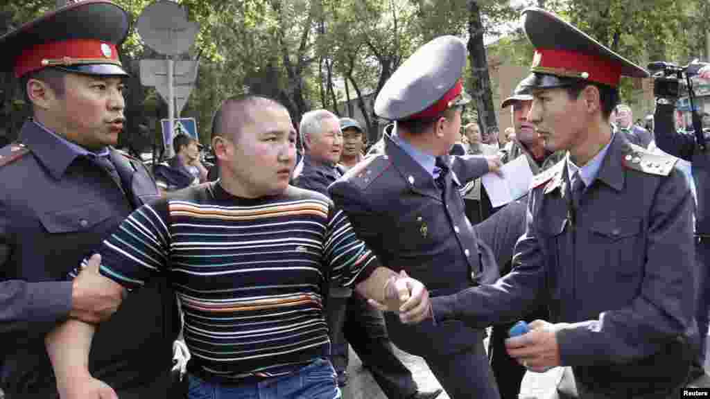 Police detain a protester during the rally