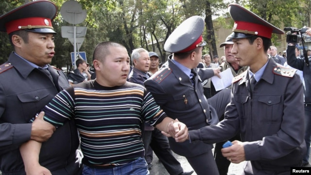 Police detain a protester during an opposition rally in Bishkek.
