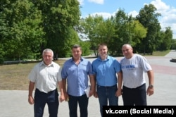 Beekeeper Andrei Malykhin (second right) and some similarly affected apiarists.