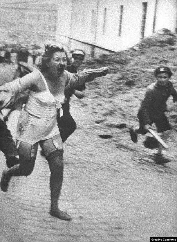 With the active encouragement of the Nazis, horror is unleashed on the Jewish population of the Soviet Ukraine and territories that had been occupied by Soviet forces. This woman is fleeing from a mob in Lviv, a Polish city overtaken by Soviet and then Nazi forces that is today part of western Ukraine -- in June or July 1941. Thousands of Jews were tormented and murdered by mobs of locals during a series of pogroms in Central and Eastern Europe.