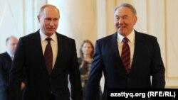 Президент России Владимир Путин (слева) и президент Казахстана Нурсултан Назарбаев (справа). Иллюстративное фото.