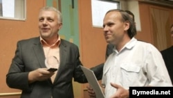 Belarus journalist Henadz Barbarych (right) was briefly detained today by the KGB. He is pictured here in 2007.