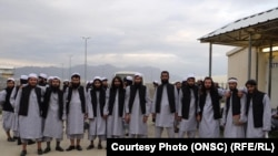 Newly freed Taliban prisoners are seen at Bagram prison, north of Kabul, on April 9.