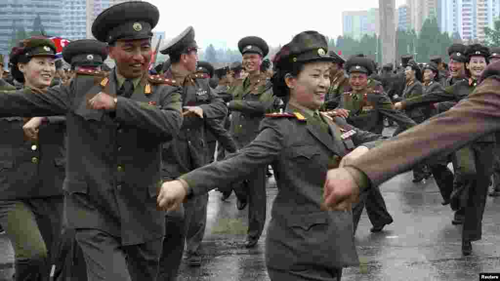 "North Korean soldiers dance at an event in Pyongyang that was held to ""offer their highest glory and congratulations"" to Kim Jong Un upon his appointment as ""marshal"" of the country's army on July 18. (REUTERS)"