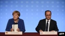 Канцлер Німеччини Анґела Меркель (ліворуч) та президент Франції Франсуа Олланд