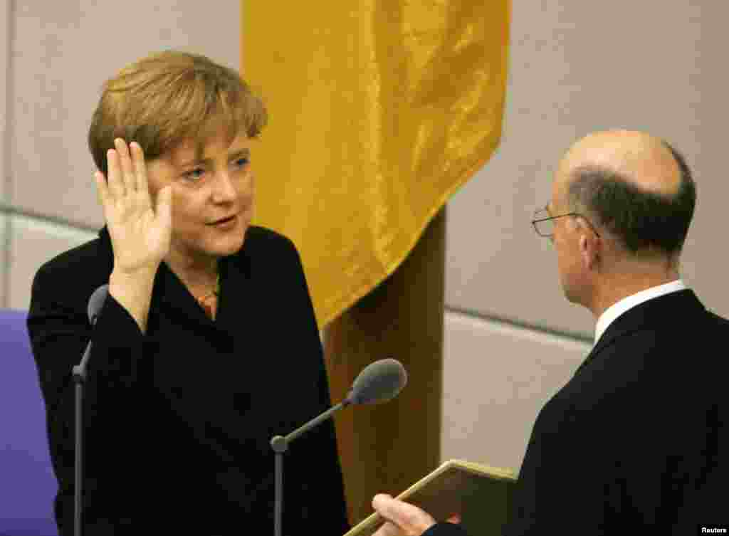 Christian Democrat leader Angela Merkel sworn in as chancellor in parliament in Berlin on November 22, 2005. Merkel, 51, became Germany's first chancellor to have grown up in the ex-communist east.