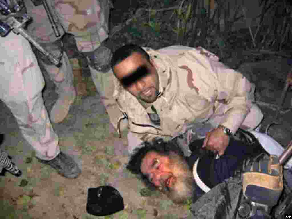 "The capture of Saddam Hussein, December 13, 2003. U.S. forces found him living underground in a so-called ""spider hole"" with scant space and spartan facilities."