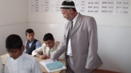 A teacher at a school in Tajikistan's Vose region