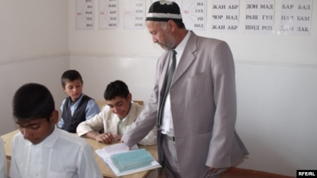 A teacher at a school in Tajikistan's Vose region