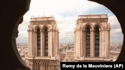 The two towers of Notre Dame Cathedral in Paris as seen from the spire in June 1998.