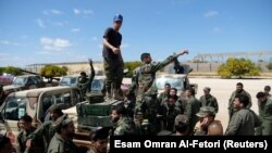Fighters from the self-styled Libyan National Army under the command of Khalifa Haftar