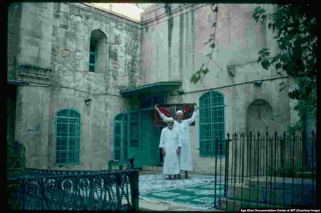 Men in the courtyard of Chalabi Mosque in 1991. After French rule collapsed, Syria suffered considerable turmoil before a 1970 coup installed the Alawite Hafez al-Assad as prime minister, then president. Assad, an air-force officer who had spent 10 months in the U.S.S.R. training as a fighter pilot, imposed a ruthless, secular-leaning police state on Syria.