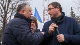 Pro-Russian opposition leaders Igor Dodon (left) and Renato Usatiialk at a protest outside the national television building of TeleRadio Moldova in Chisinau, January 22, 2016