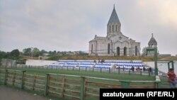Nagorno-Karabakh -- A football pitch for children and an Armenian church in Shushi (Shusha), September 6, 2018.