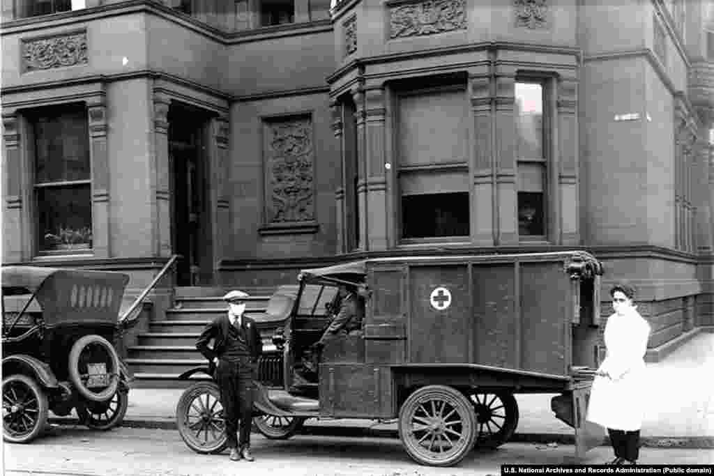 An ambulance in front of the Girls Club of Philadelphia amid the 1918 Spanish flu epidemic. The building was used as an emergency hospital. More than 45,000 people in Philadelphia were infected with the influenza within a week of the Liberty Loan Parade and more than 12,000 of the city's citizens were dead.