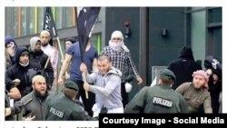 Мусульманин, сопротивлявшийся немецким полицейским с черным флагом в руках, похожим на флаг ИГИЛ, сразу привлек к себе внимание СМИ