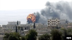 An explosion is seen during fighting in the Syrian border town of Kobani on October 3.