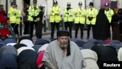 Radical Muslim cleric Abu Hamza al-Masri is seen leading prayers outside the North London Central Mosque in Finsbury Park, north London, in 2003.