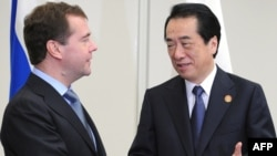 Russian President Dmitry Medvedev, left, shakes hands with Japanese Prime Minister Naoto Kan ahead of the Asia Pacific Economic Cooperation (APEC) Summit.