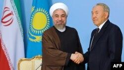 Қазақстан президенті Нұрсұлтан Назарбаев (оң жақта) пен Иран президенті Хассан Роухани. Астана, 9 қыркүйек 2014 жыл.