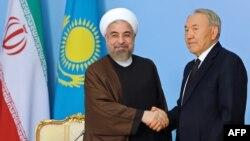 Казакстан президенти Ирандын жетекчиси менен.