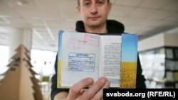 Ukrainian novelist Serhiy Zhadan, in Minsk, shows a stamp in his passport that denies him entry to Belarus.