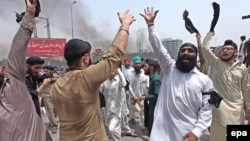 FILE: Members of minority Sikh community shout protest in the northwestern city of Peshawar.