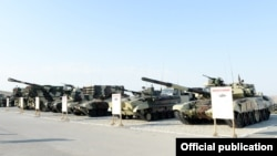 Azerbaijan - Russian-made tanks and artillery systems are put on display during exercises conducted by the Azerbaijani army, 26Jun2014.