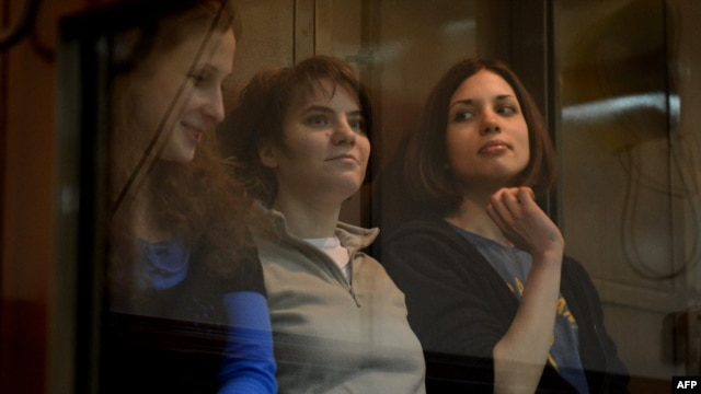 Pussy Riot defendants Yekaterina Samutsevich, Maria Alyokhina, and Nadezhda Tolokonnikova (left to right) sit in the dock during their appeal hearing in Moscow on October 1.