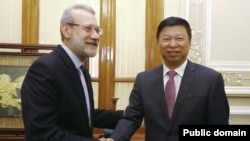 Iran's parliament speaker Ali Larijani meeting China's Song Tao in Tehran on July 30, 2019.