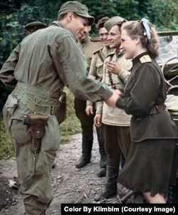 An American soldier (left) greets a Soviet officer in Seoul in 1945. Five years later the United States and the U.S.S.R. were on opposite sides in the Korean War.