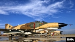 Iranian Air Force F-4 Fighter jet displayed at press conference in Isfahan
