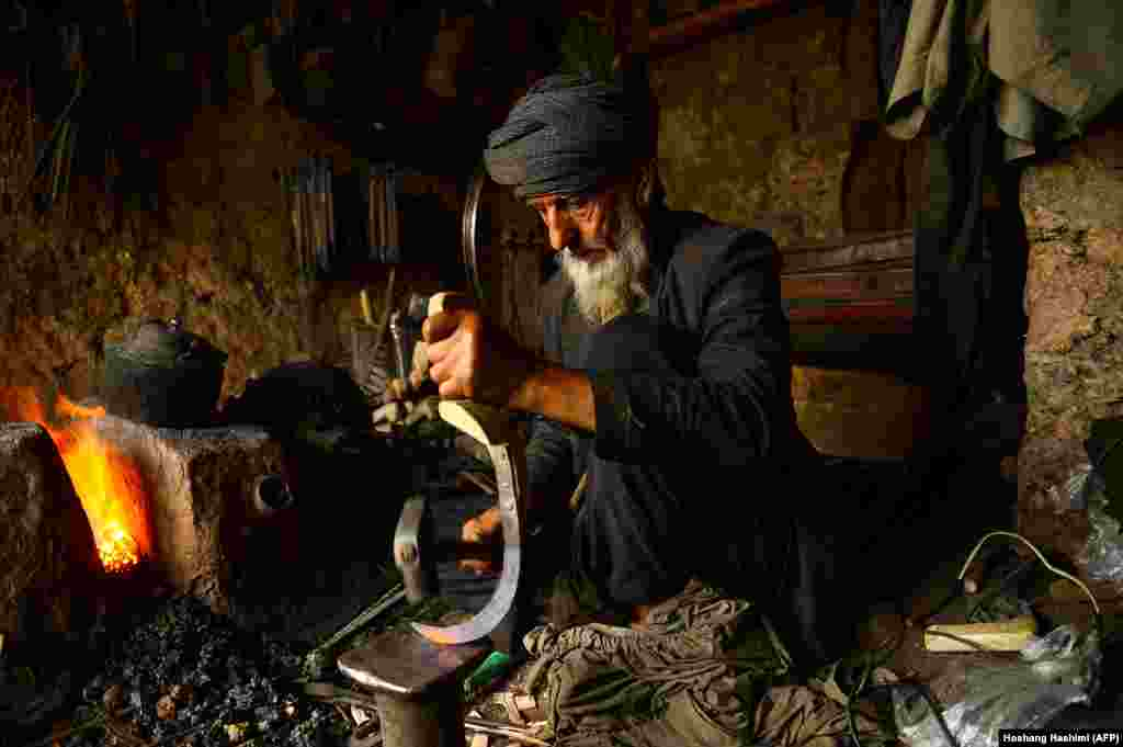 An Afghan blacksmith forges a tool at his workshop in Herat city. (AFP/Hoshang Hashimi)