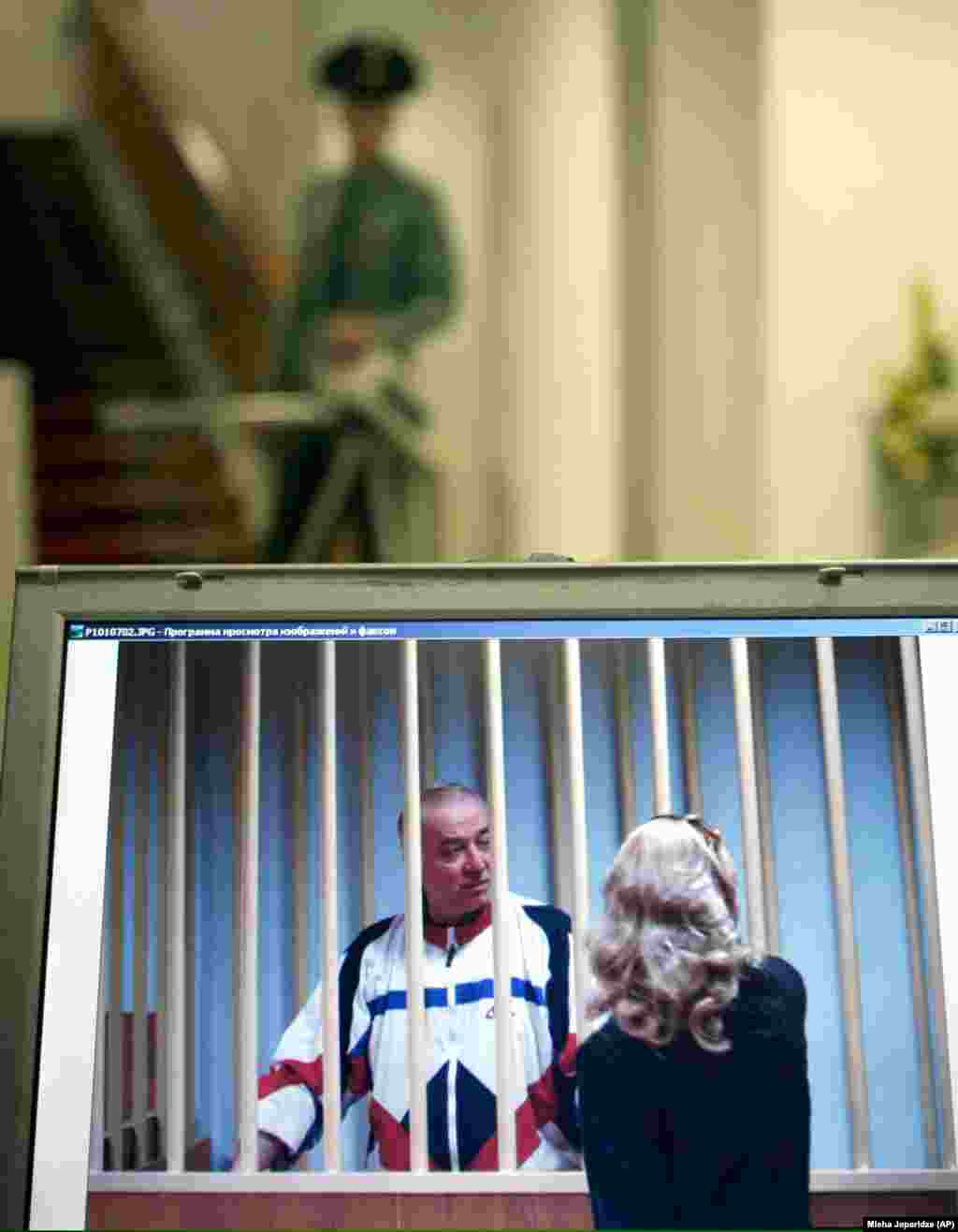 Russian military intelligence officer Sergei Skripal was among the four people released by Russia. A monitor outside a Moscow courtroom shows Skripal speaking to his lawyer during a 2006 trial in which he was convicted of spying for the U.K. After the spy swap, Skripal ended up living in England, where he was poisoned in 2018, allegedly by two Russian suspects. Skripal and his daughter almost died in the attack. Moscow denied accusations that it tried to kill him.