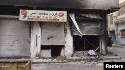 Дом, сожженный в ходе боев в окрестностях сирийского города Хомс