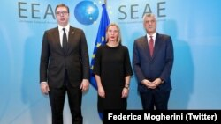 The EU's Federica Mogherini (middle), Kosovo's Hashim Thaci (right) and Serbian president Aleksandar Vucic meet.