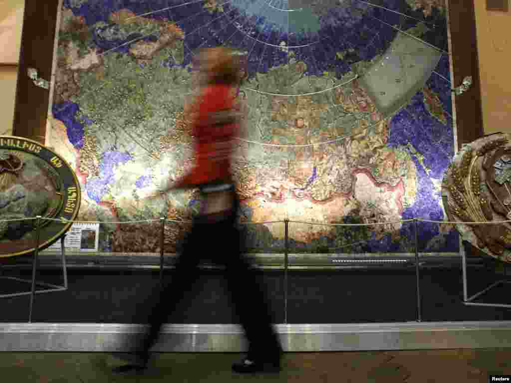 A visitor walks past a map of the USSR studded with semiprecious stones at a geological exploring museum in St. Petersburg on November 14. (REUTERS/Alexander Demianchuk)