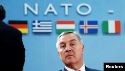 "Are Montenegro's pro-Western leaders, including former Prime Minister Milo Djukanovic (pictured), trying to ""drag"" the Balkan country into NATO against public opinion, as Moscow claims?"