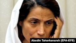 Human rights activist Nasrin Sotoudeh talks on the phone at her house in Tehran, September 18, 2013