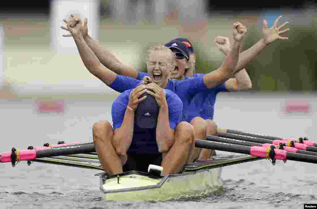 Ukrainian rowers Yana Dementieva (front), Anastasiia Kozhenkova, Nataliya Dovgodko, and Kateryna Tarasenko celebrate winning the women's quadruple sculls at the London games. (REUTERS/Natacha Pisarenko)