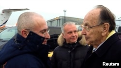 Germany -- Hans-Dietrich Genscher (R) of the liberal Free Democratic Party (FDP) welcomes Russian former oil tycoon Mikhail Khodorkovsky at Berlin's Schonefeld airport, December 20, 2013