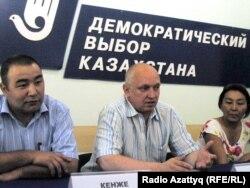 Социалдык кастыкты козутту деп айыпталып жаткан Владимир Козлов жана Айжангүл Амирова.
