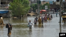 Heavy monsoon rains triggered floods Pakistan's port city of Karachi on August 27.