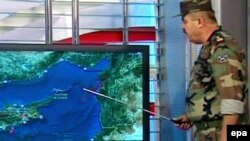 A TV grab shows a Syrian military spokesman explaining on a map on June 23 that resulted in a Turkish fighter being shot down.
