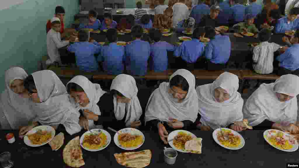 Visually impaired and blind students eat their meals at the school.