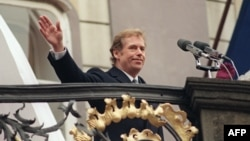 Vaclav Havel waves to wellwishers shortly after he took the oath as president of Czechoslovakia on December 29, 1989.